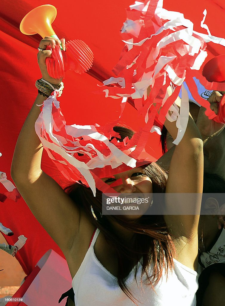 Peru's fan cheers for their team before the South American U-20 final round football match against Chile at Malvinas Argentinas stadium in Mendoza, Argentina, on February 3, 2013. Four South American teams will qualify for the FIFA U-20 World Cup Turkey 2013.