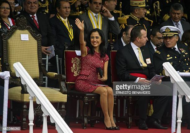 Peru's first lady Nadine Heredia waves during the traditional military parade commemorating the country's independence anniversary in Lima on July 29...