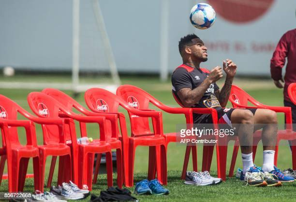 Peru's footballer Jefferson Farfan heads the ball during a training session in Lima on October 2 2017 ahead of their upcoming 2018 World Cup football...