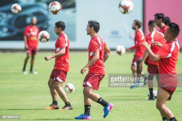 Peru's footballer Miguel Trauco takes part in a training session in Lima on March 26 2017 ahead of their World Cup qualifier matches against Uruguay...