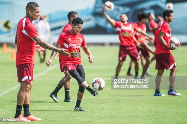 Peru's footballers Paolo Guerrero and Raul Ruidiaz take part in a training session in Lima on March 26 2017 ahead of their World Cup qualifier...