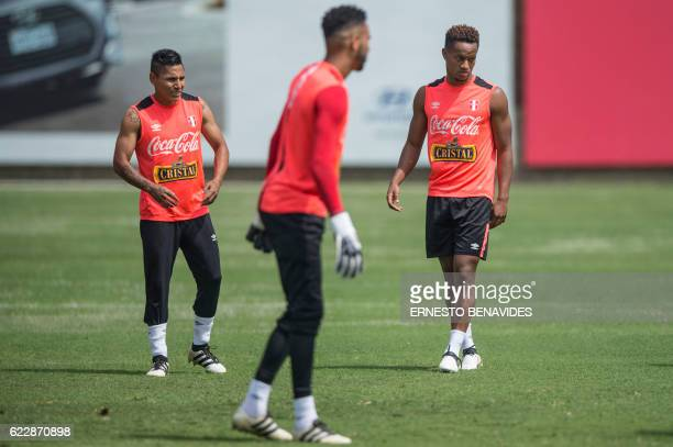 Peru's footballers Raul Ruidiaz Andre Carrillo and goalkeaper Pedro Gallese take part in a training session in Lima on November 12 ahead of their WC...