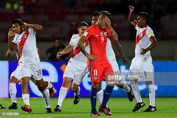 Peru's forward Edison Flores celebrates after scoring against Chile during their Russia 2018 World Cup qualifier football match in Santiago on...