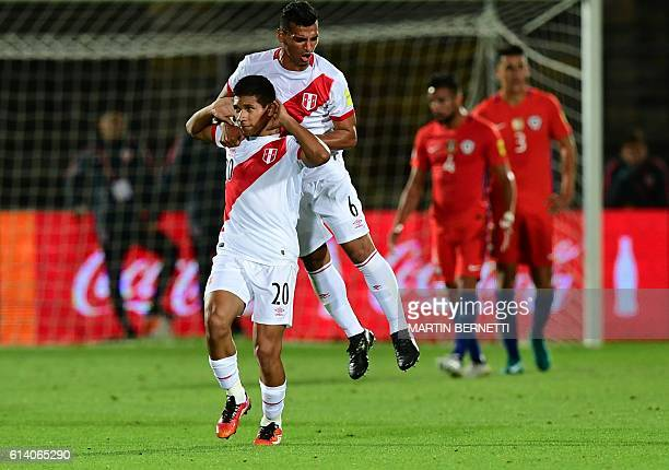 Peru's forward Edison Flores celebrates with Peru's defender Miguel Trauco after scoring against Argentina during their Russia 2018 World Cup...