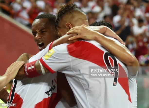 Peru's forward Edison Flores celebrates with teammates after scoring against Uruguay during their 2018 FIFA World Cup qualifier football match in...