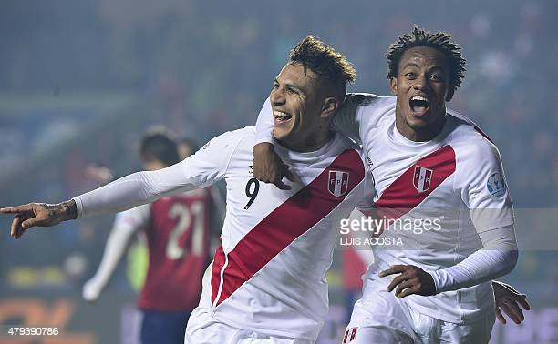Peru's forward Paolo Guerrero celebrates with teammate Andre Carrillo after scoring against Paraguay during the Copa America third place football...