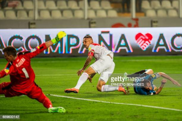 Peru's forward Paolo Guerrero scores against Uruguay during their 2018 FIFA World Cup qualifier football match in Lima on March 28 2017 / AFP PHOTO /...