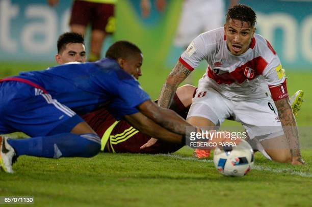 Peru's forward Paolo Guerrero vies for the ball with Venezuela's goalkeeper Wuilker Farinez during their 2018 FIFA World Cup qualifier football match...