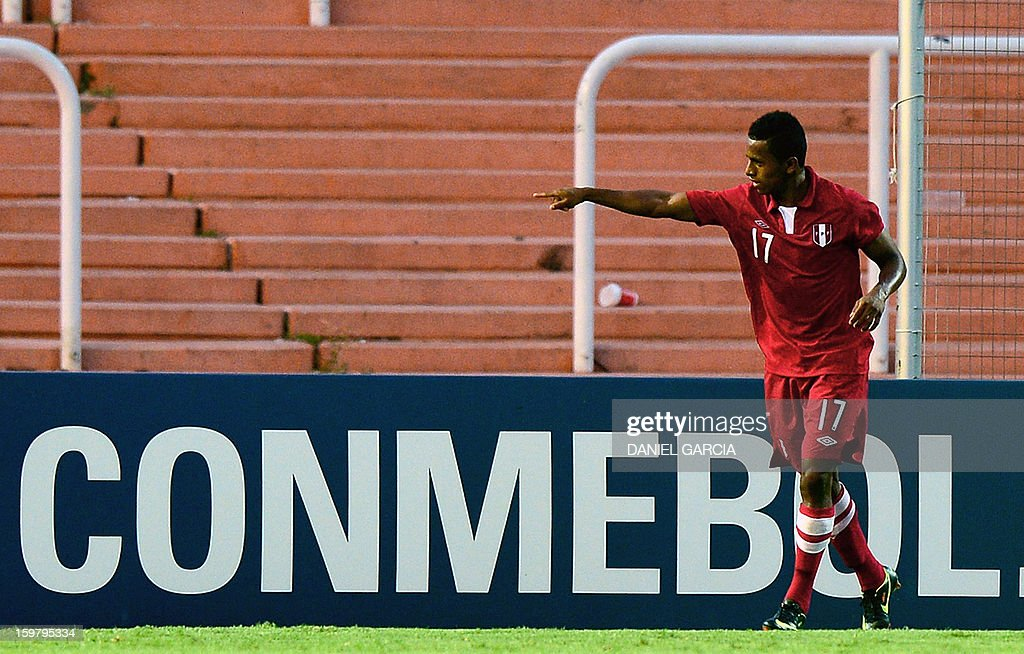 Peru's forward Yordi Reina celebrates after scoring against Uruguay during their South American U-20 final round football match at Malvinas Argentinas stadium in Mendoza, Argentina, on January 20, 2013. Four teams will qualify for the FIFA U-20 World Cup Turkey 2013.