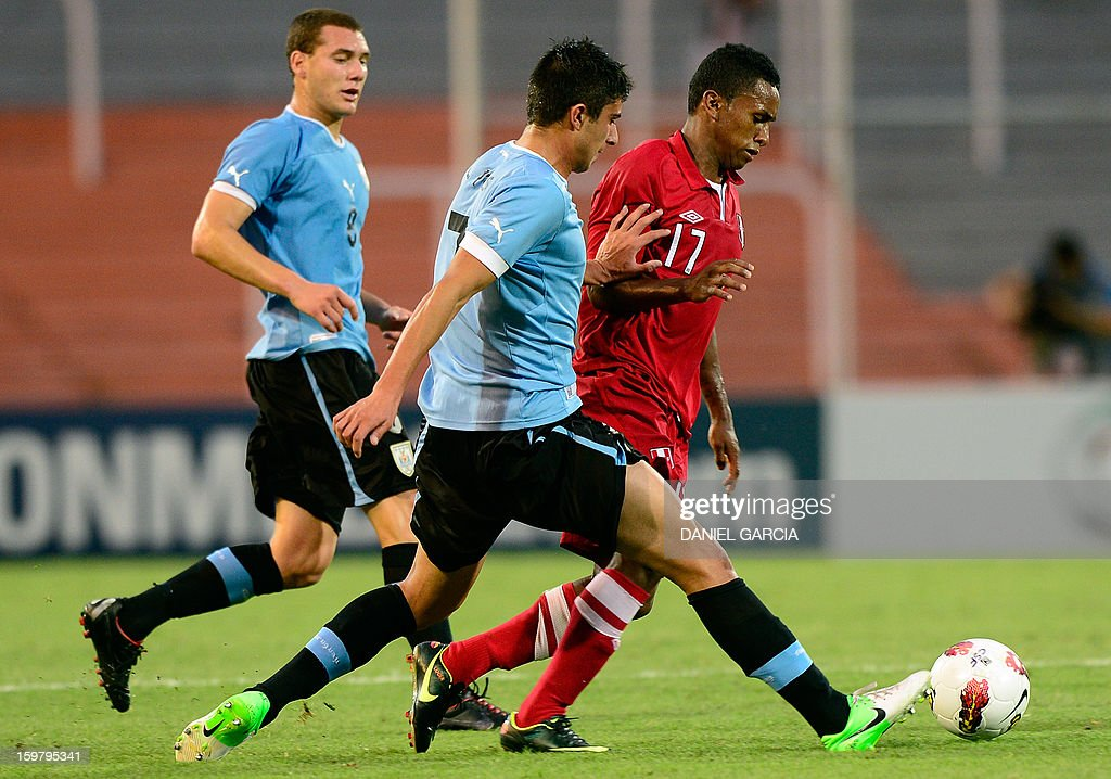 Peru's forward Yordi Reina (R) vies for the ball with Uruguay's midfielder Sebastian Cristoforo and defender Gianni Danielle Rodriguez during their South American U-20 final round football match at Malvinas Argentinas stadium in Mendoza, Argentina, on January 20, 2013. Four teams will qualify for the FIFA U-20 World Cup Turkey 2013.