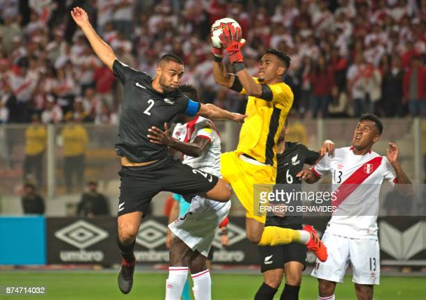 Peru's goalkeeper Pedro Gallese grabs the ball next to New Zealand's Winston Reid during their 2018 World Cup qualifying playoff second leg football...