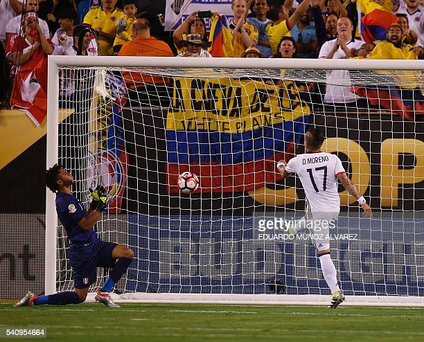 Peru's goalkeeper Pedro Gallese reacts after the penalty scored by Colombia's Dayro Moreno during the Copa America Centenario quarterfinal football...