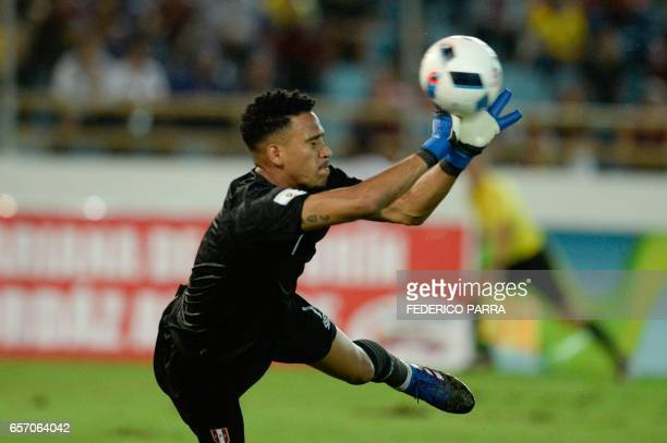 Peru's goalkeeper Pedro Gallese stops the ball during their 2018 FIFA World Cup qualifier football match against Venezuela in Maturin Venezuela on...