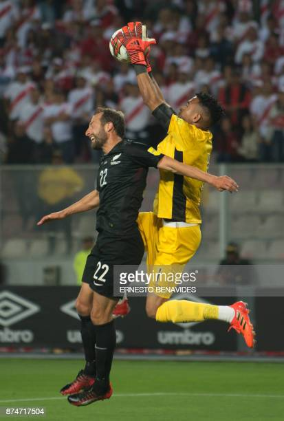 Peru's goalkeeper Pedro Gallese vies for the ball New Zealand's Andrew Durante during their 2018 World Cup qualifying playoff second leg football...