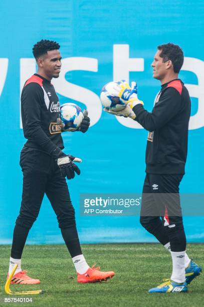 Peru's goalkeepers Pedro Gallese and Leao Butron take part in a training session in Lima on October 4 2017 ahead of their upcoming 2018 FIFA World...