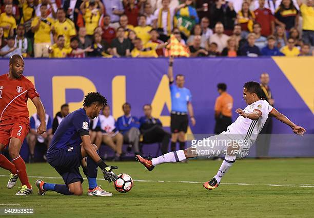 Peru's golakeeper Pedro Gallese and Colombia's Carlos Bacca vie for the ball during their Copa America Centenario quarterfinal football match in East...