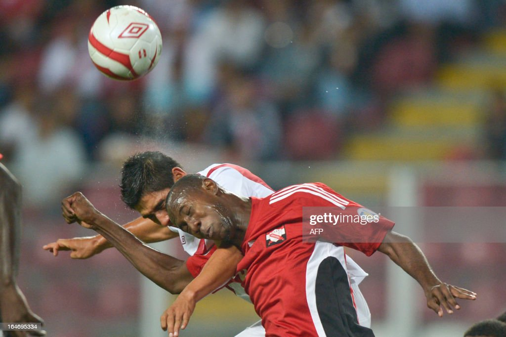Peru's Irven Avila (L) vies for the ball with Cyrus Daniel (R) of Trinidad & Tobago during a friendly match at at the National stadium in Lima on March 26, 2013.