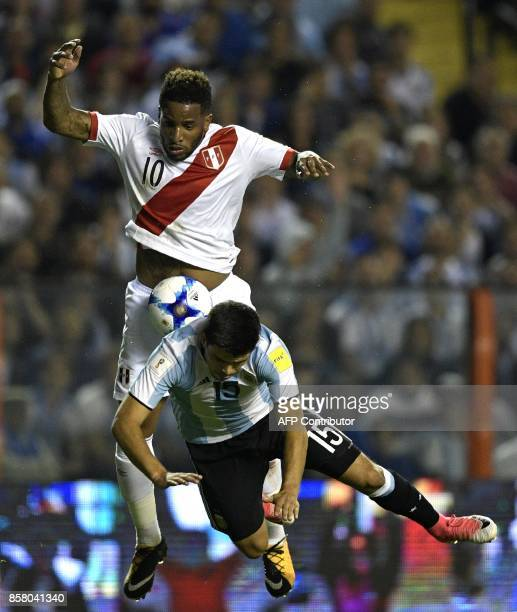 Peru's Jefferson Farfan and Argentina's Marcos Acuna vie for the ball during their 2018 World Cup qualifier football match in Buenos Aires on October...
