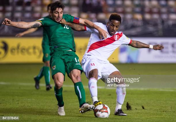 Peru's Jefferson Farfan and Bolivia's Ronald Raldes vie for the ball during their 2018 World Cup qualifier football match in Lima on August 31 2017 /...