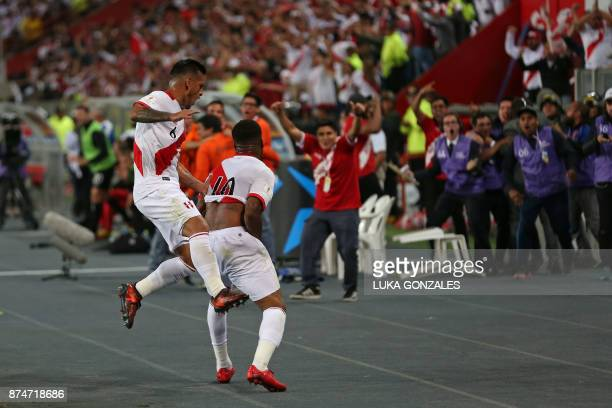 Peru's Jefferson Farfan celebrates with teammate Miguel Trauco after scoring against New Zealand during their 2018 World Cup qualifying playoff...