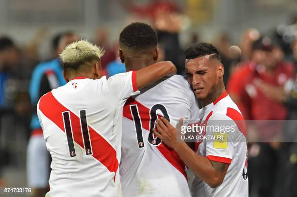 Peru's Jefferson Farfan celebrates with teammates Peru's Raul Ruidiaz and Miguel Trauco after scoring against New Zealand during their 2018 World Cup...