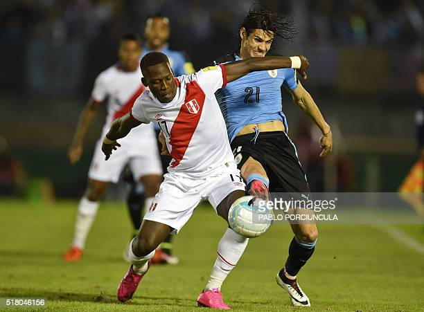Peru's Luis Advincula and Uruguay's Edinson Cavani vie for the ball during their Russia 2018 FIFA World Cup South American Qualifiers' football match...