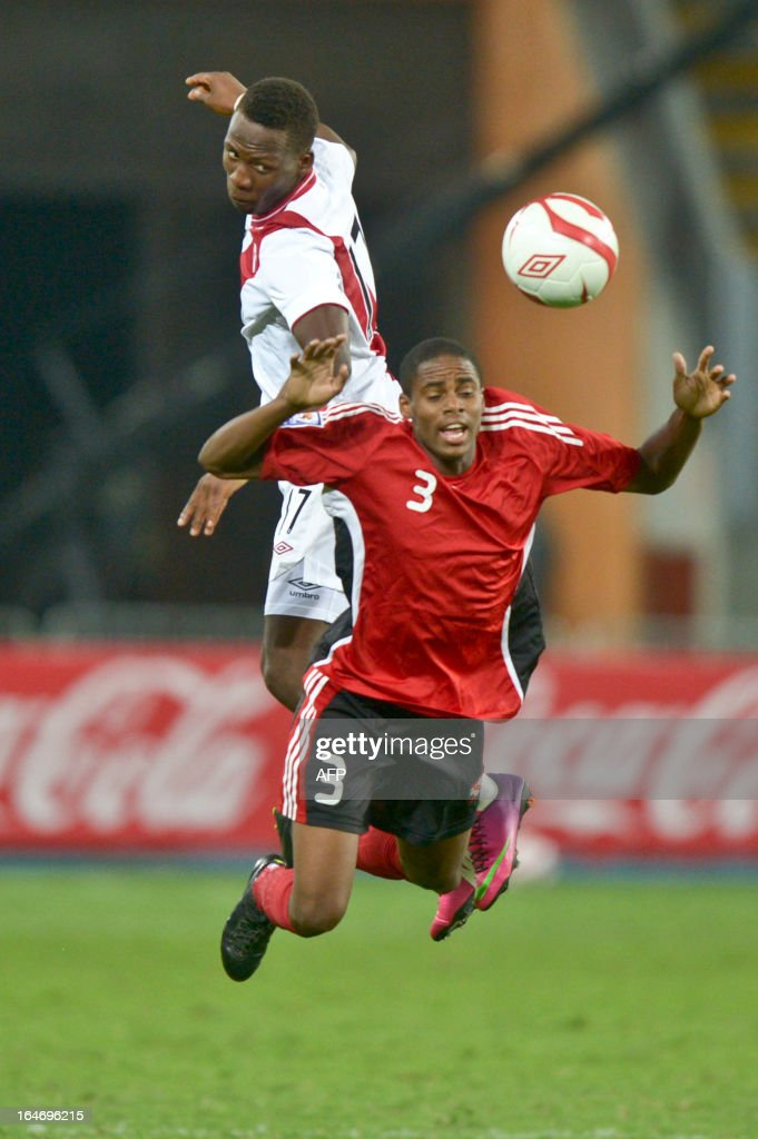 Peru's Luis Advincula (L)vies for the ball with Jones Joevin (R) of Trinidad & Tobago during a friendly match at at the National stadium in Lima on March 26, 2013.