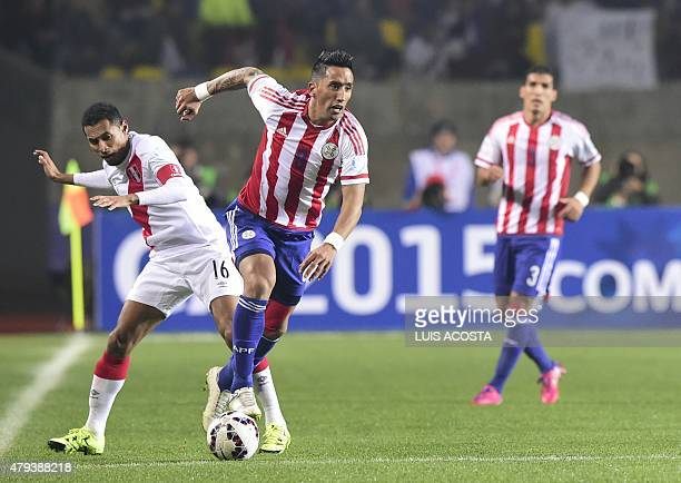 Peru's midfielder Carlos Lobaton vies for the ball with Paraguay's forward Lucas Barrios during the Copa America third place football match in...
