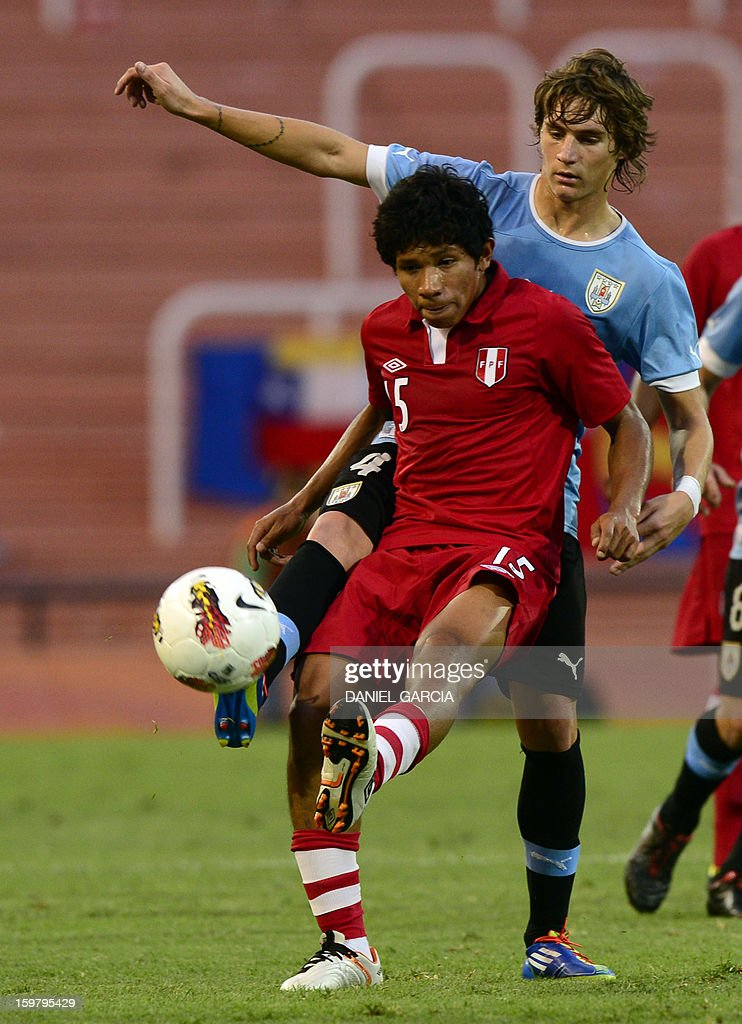 Peru's midfielder Edison Flores (front) vies for the ball with Uruguay's defender Guillermo Varela during their South American U-20 final round football match at Malvinas Argentinas stadium in Mendoza, Argentina, on January 20, 2013. Four teams will qualify for the FIFA U-20 World Cup Turkey 2013.