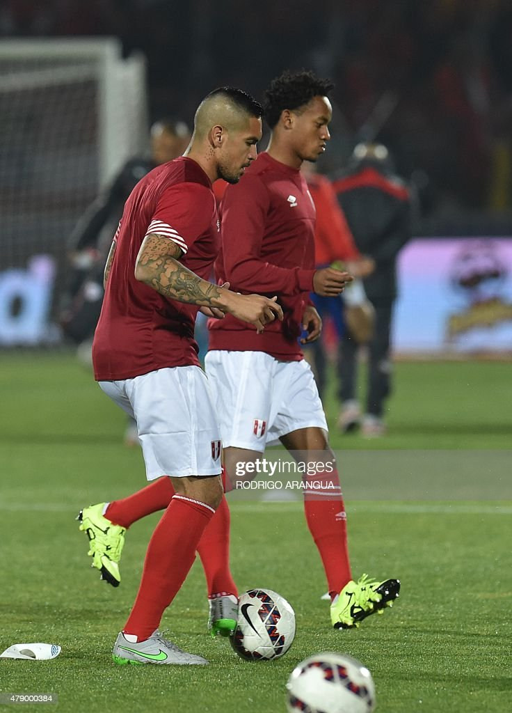 Peru's midfielder <a gi-track='captionPersonalityLinkClicked' href=/galleries/search?phrase=Juan+Vargas+-+Soccer+Player&family=editorial&specificpeople=4167791 ng-click='$event.stopPropagation()'>Juan Vargas</a> (L) and forward Andre Carrillo warm up before the start of their 2015 Copa America football championship semi-final match against Chile, in Santiago, on June 29, 2015. AFP PHOTO / RODRIGO ARANGUA