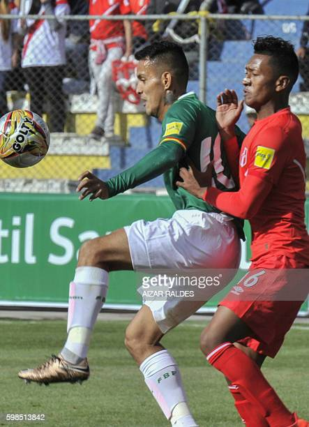 Peru's midfielder Pedro Aquino and Bolivia's midfielder Jhasmany Campos vie for the ball during the Russia 2018 World Cup qualifier football match at...