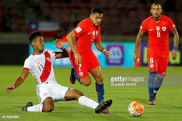 Peru's midfielder Renato Tapia vies for the ball with Chile's forward Alexis Sanchez and midfielder Arturo Vidal during their Russia 2018 FIFA World...