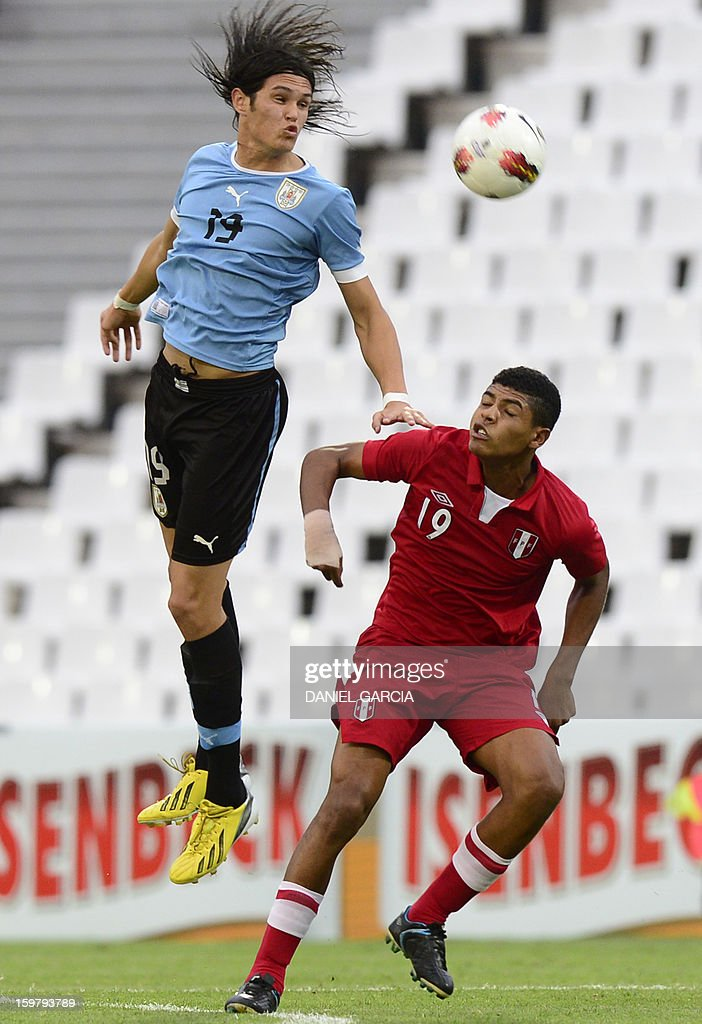 Peru's midfielder Wilder Cartagena (R) vies for the ball with Uruguay's forward Ruben Betancourt during their South American U-20 final round football match at Malvinas Argentinas stadium in Mendoza, Argentina, on January 20, 2013. Four teams will qualify for the FIFA U-20 World Cup Turkey 2013.