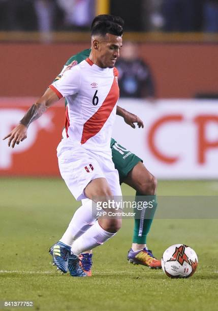 Peru's Miguel Trauco is marked by Bolivia's Jhasmany Campos during their 2018 World Cup qualifier football match in Lima on August 31 2017 / AFP...