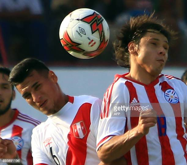 Perus national football team Miguel Trauco vies for the ball with Paraguays Angel Romero during their friendly match on June 8 at the Mansiche...