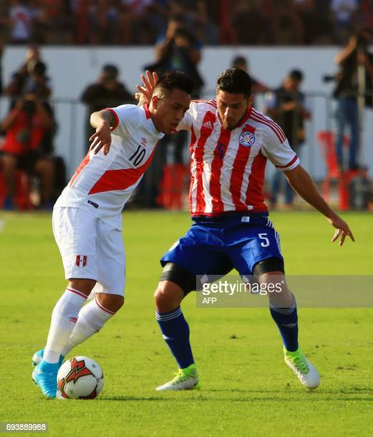 Perus national football team player Christian Cueva vies for the ball with Paraguays Bruno Valdez during their friendly match on June 8 at the...