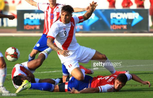 Perus national football team player Paolo Guerrero vies for the ball with Paraguays Bruno Valdez during their friendly match on June 8 at the...