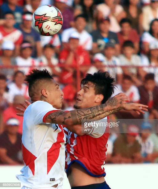 Perus national football team player Paolo Guerrero vies for the ball with Paraguays Juan Aguilar during their friendly match on June 8 2017 at the...