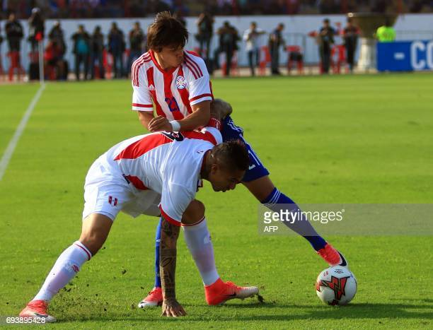 Perus national football team player Yoshimar Yotun vies for the ball with Paraguays Oscar Romero during their friendly match on June 8 at the...