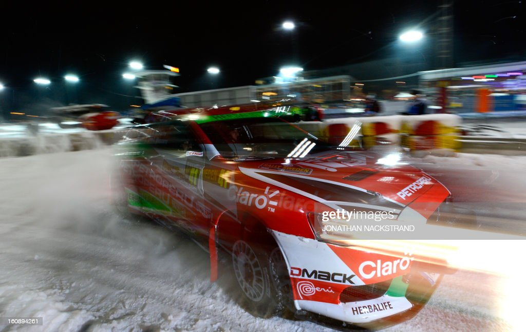 Peru's Nicolas Fuch and his co-driver Argentina's Fernando Mussano steer their Mitsubishi Lancer EVO X during the 1st stage of the Rally Sweden, second round of the FIA World Rally Championship on February 7, 2013 in Karlstad, Sweden. NACKSTRAND