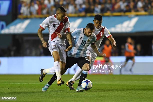 Peru's Paolo Guerrero and Argentina's Lionel Messi vie for the ball during their 2018 World Cup football qualifier match in Buenos Aires on October 5...