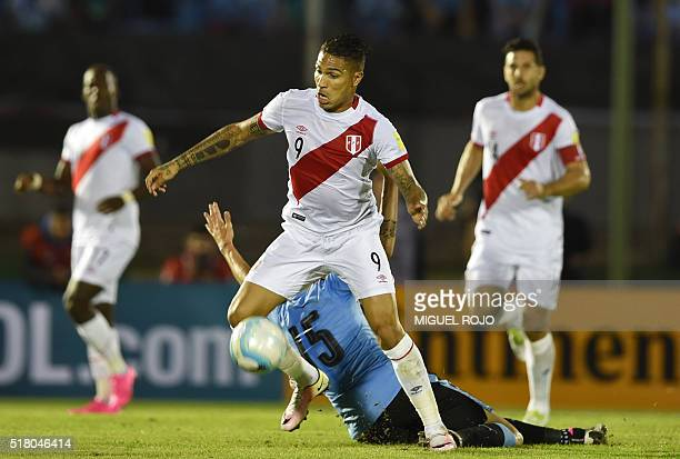 Peru's Paolo Guerrero controls the ball past Uruguay's Matias Vecino during their Russia 2018 FIFA World Cup South American Qualifiers' football...