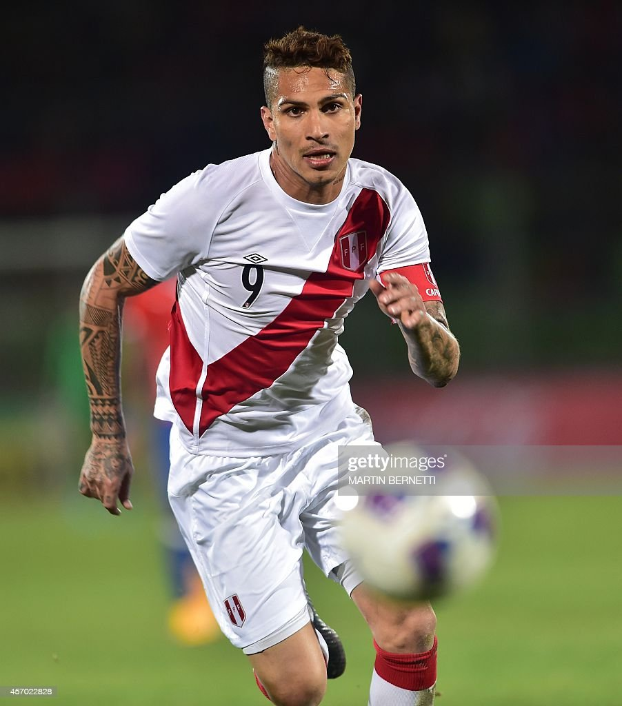 Peru s Paolo Guerrero eyes the ball during a friendly football