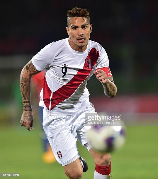 Peru's Paolo Guerrero eyes the ball during a friendly football match against Chile at the Elias Figueroa stadium in Valparaiso Chile on October 10...