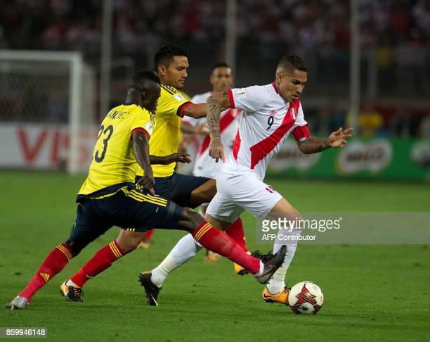 Peru's Paolo Guerrero fights for the ball with Colombia's Davinson Sanchez and Abel Aguilar during their 2018 World Cup qualifier football match in...