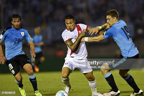 Peru's Paolo Guerrero is marked by Uruguay's Sebastian Coates as Uruguay's Alvaro Gonzalez look on during their Russia 2018 FIFA World Cup South...