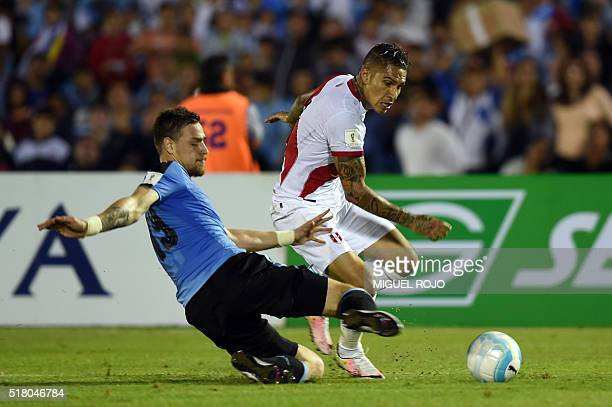 Peru's Paolo Guerrero is marked by Uruguay's Sebastian Coates during their Russia 2018 FIFA World Cup South American Qualifiers' football match at...