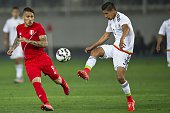 Peru's Paolo Guerrero vies for the ball Mexico's Hugo Ayala during a friendly football match at the National Stadium in Lima on June 3 ahead of the...