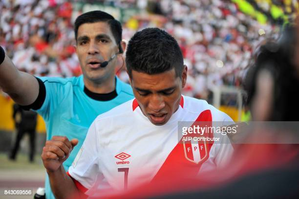Peru's Paolo Hurtado celebrates after scoring the team's second goal against Ecuador during their 2018 World Cup qualifier football match in Quito on...