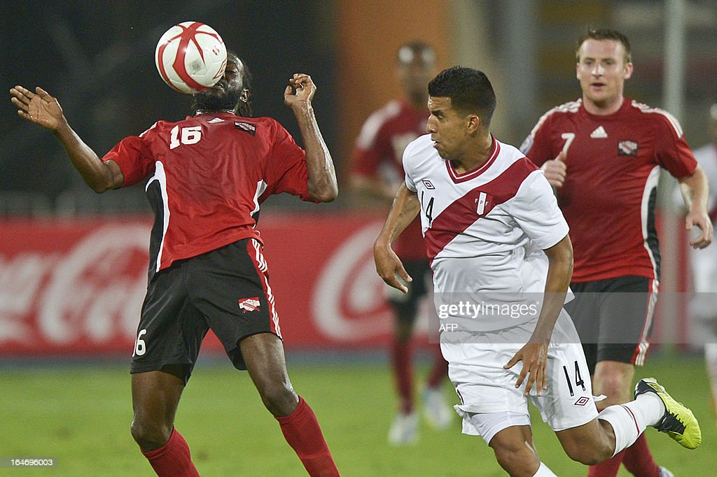 Peru's Paulo Albarracin (R) vies for the ball with Edwards Keyom of Trinidad & Tobago (L) during a friendly match at the National stadium in Lima on March 26, 2013.